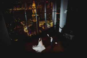 A bride and groom practice their first dance after getting married at Boston's State Room.