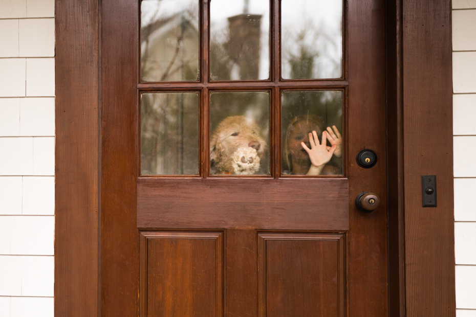 Kids and dogs greet visitors at the door of their Wayland Massachusetts home
