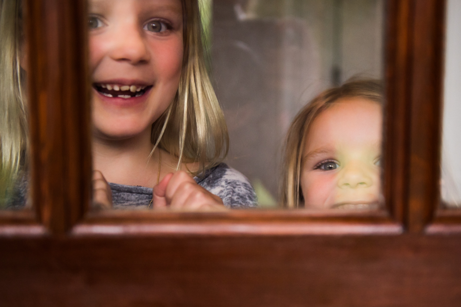 Kids greet visitors at the door of their Wayland Massachusetts home